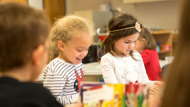 Michigamme Elementary School kindergarteners Nevaeh Fortier, left, and Kiersten Orlando work during class Feb. 28.