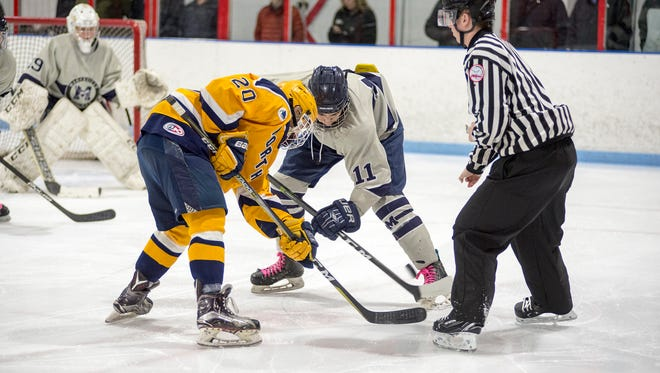 Port Huron Northern High School's Dakota Truscott (2) faces off with Marysville High School's Tyler Shoudy during their hockey game at Glacier Pointe March 1.