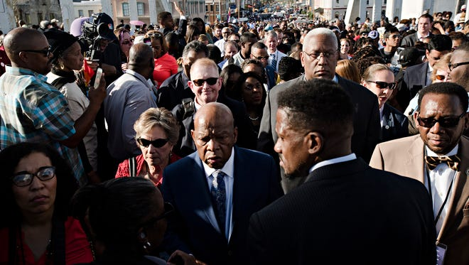 Congressman John Lewis crosses the Edmund Pettus Bridge during the Bridge Crossing Jubilee in commemoration of the 53rd anniversary of Bloody Sunday on Sunday, March 4, 2018, in Selma, Ala.
