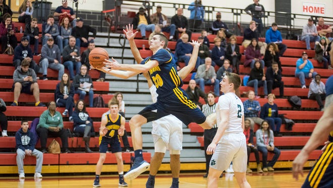 Port Huron Northern High School's Dane Vos (30) jumps for a layup during the MHSAA Class B District Semifinal against Macomb Dakota High School at Anchor Bay High School March 7.