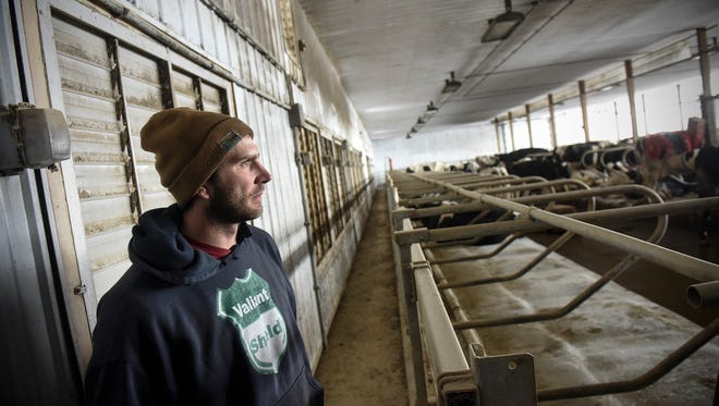 Isaak Hinnenkamp talks about the installation of robotic milking equipment and a new barn Tuesday, March 6, during a tour of his farm near Melrose.