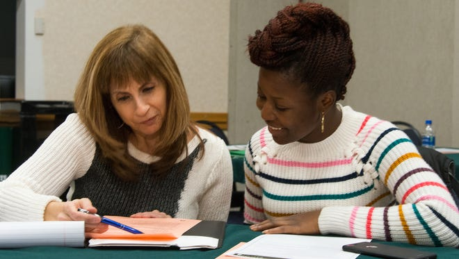 Sanofi mentor Filomena Masullo (left) works with RVCC student Janet Adeleke during a meeting at RVCC's Branchburg campus.