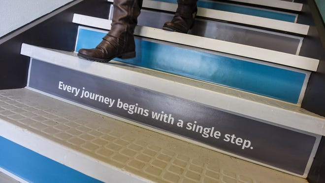 Words of encouragement are written on the stairs leading to Pathways 4 Youth, a homeless youth opportunity center, in St. Cloud.