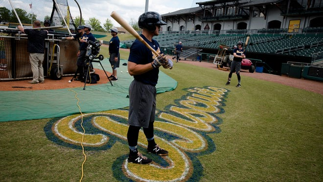 Biscuits players prepare for batting practice during the Biscuits opening practice on Tuesday, April 3, 2018, in Montgomery, Ala.