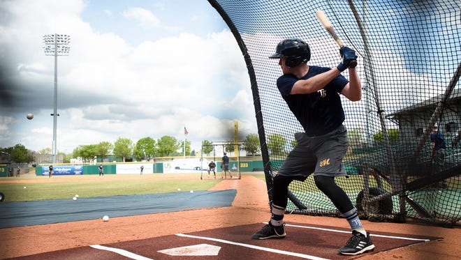 Biscuits short stop Jake Cronenworth goes to hit the ball during the Biscuits opening practice on Tuesday, April 3, 2018, in Montgomery, Ala.