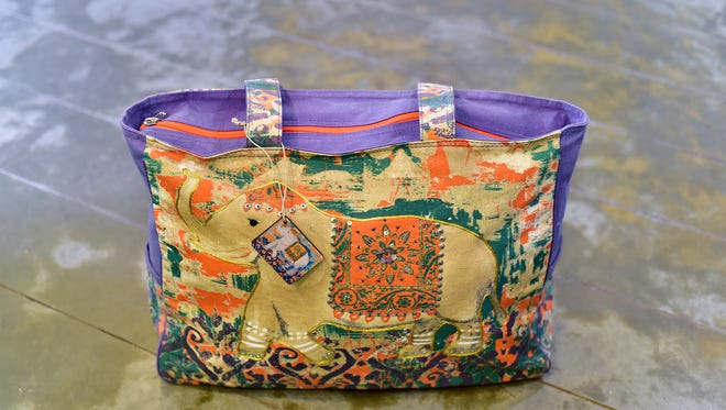 Sun n' Sand elephant print tote, $39.50, The International Boutique and Gift Shop.