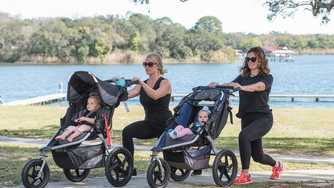 Jessica Marickovich and daughter Ella with Amber Roberts Clark and daughter Stella, lunges.