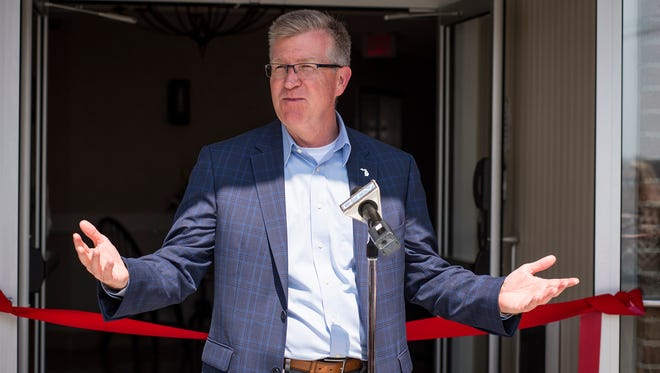 Michigan Economic Development Corporation CEO Jeff Mason speaks at the ribbon cutting for the Inn on Water Street in Marine City Friday, May 4.