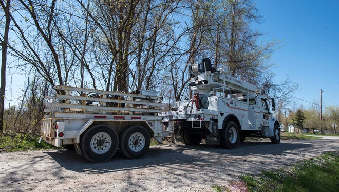 A utility truck from Xtreme Powerline Construction sits in a neighborhood off of Moak Street in May. DTE Energy is showing a power outage in that area.
