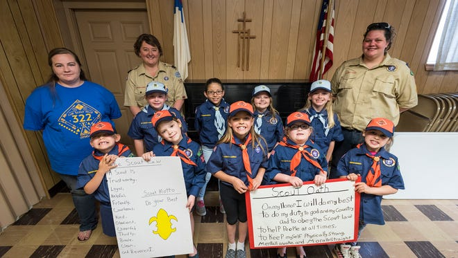 The girls in Cub Scouts Pack 322 Tiger and Bear dens of Croswell, Michigan, pictured with their den leaders on May 15, are the first group of girls in the program to gain ranks in the United States.