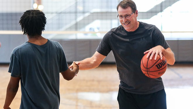 "From left, David Flonnery, 18, and his mentor Rick Monroe, 56, from Big Brothers Big Sisters of Central Indiana, tap hands in passing while playing basketball at the Irsay Family YMCA at CityWay in Indianapolis, Wednesday, May 9, 2018. Monroe has become a friend and ""father figure"" to David and his little brother Joshua in the three years since they matched, bonding immediately over their shared love of basketball Monroe has taught David to always try new things and how to exude confidence. There are 900 children between the ages of 8 and 14 waiting to be matched with a mentor through the program."