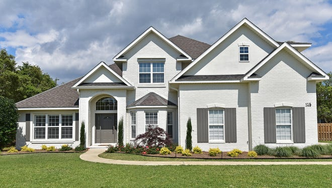 Waghalter changed the exterior by painting the home and scaling back the landscaping.