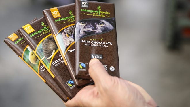 A few varieties of Endangered Species Chocolate bars are seen at the company's offices and production plant in Indianapolis, Tuesday, May 29, 2018. The company relocated to Indianapolis 13 years ago, and has since donated $5 million toward efforts to conserve wildlife and endangered species.
