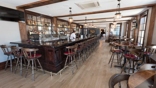 The bar inside the restaurant at the Cadillac House. The bar has been reconstructed based on historic photos of the hotel.