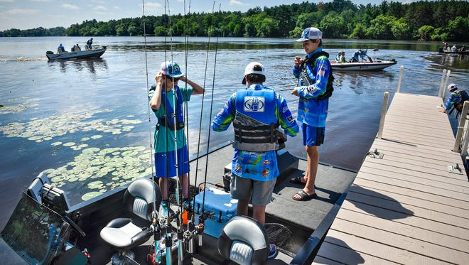 Anglers get ready to leave the dock and start fishing during a SabreStorm Fishing Team event Wednesday, June 27, on the Mississippi River.
