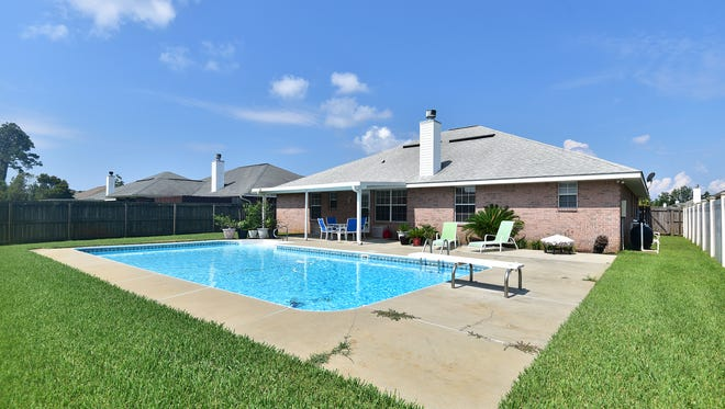1294 Harrison Avenue, enjoy pool parties all summer.