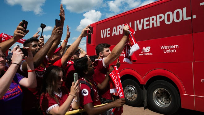 Liverpool fans cheer as the team bus arrives at Michigan Stadium in Ann Arbor on July 28, 2018 before the International Champions Cup match vs. Manchester United.