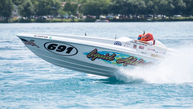 The Liquid Addiction boat bounces over waves at the start of the Class 6 race Sunday, July 29, 2018 during the Offshore Powerboat races in St. Clair.