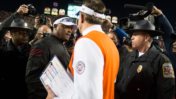 Texas A&M Head Coach Kevin Sumlin greets Auburn Head Coach Gus Malzahn after the NCAA football game between Auburn and Texas A&M on Saturday, Nov. 8, 2014, in Auburn, Ala. Texas A&M defeated Auburn 41-28 after Auburn fumbled twice on there last two drives.