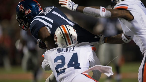 Auburn defensive back Derrick Moncrief (24) and Auburn defensive back Jonathon Mincy (6) tackles Mississippi wide receiver Laquon Treadwell (1) during the NCAA football game at University of Mississippi in Oxford, Miss., on Saturday, Nov. 1, 2014. Auburn defeated Mississippi 35-31.