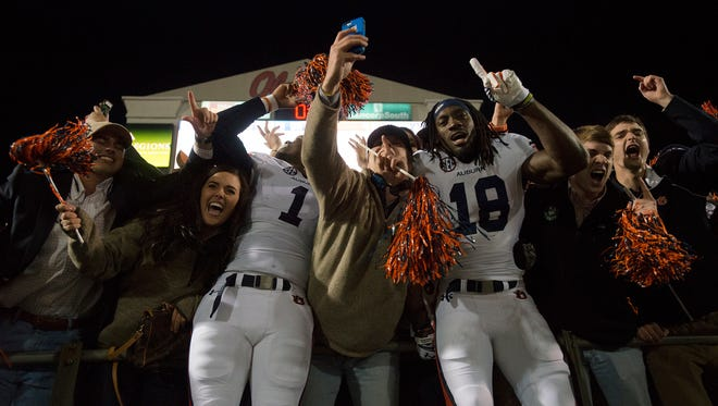 Auburn wide receiver D'haquille Williams (1) and Auburn wide receiver Sammie Coates (18) celebrate with fans after the NCAA football game at University of Mississippi in Oxford, Miss., on Saturday, Nov. 1, 2014. Auburn defeated Mississippi 35-31