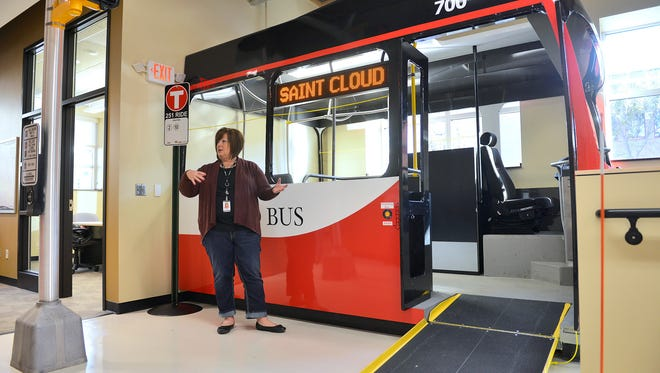 Debbie Anderson, community outreach and travel training coordinator for Metro Bus, talks Friday, Oct. 10 about the features of the new Metro Bus Mobility Training Center, including a mock up ramp and bus interior complete with seats, a steering wheel, and fare collection system.