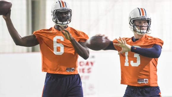 Auburn quarterbacks Jeremy Johnson (6) and Sean White (13) warm up during practice at Sports Blast Shelby County in Birmingham on Dec. 28, 2015.