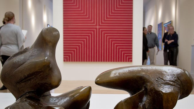 """Frank Stella's painting """"Delaware Crossing"""" is juxtaposed with a Henry Moore sculpture, just like the pieces were placed in A. Alfred Taubman's Bloomfield Hills home, in Sotheby's exhibit of the billionaire's collection."""