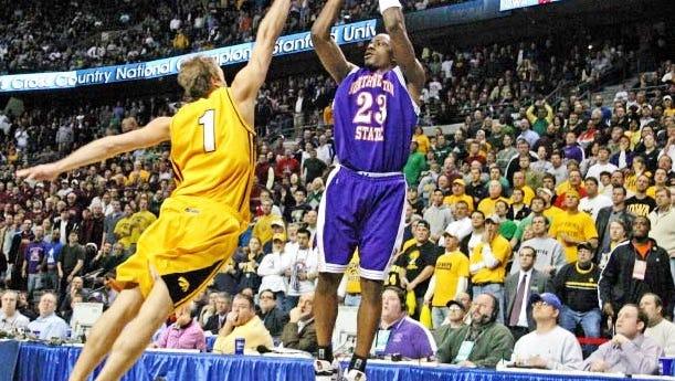 Northwestern State's Jermaine Wallace hits the game-winning shot over Iowa's Adam Haluska in the Demons' 64-63 upset in the 2006 NCAA Tournament.