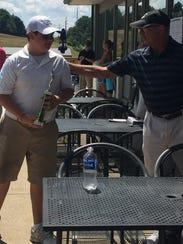 Marc Wilkins Jr. accepts congratulations from tournament
