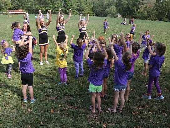 Indianola High School cheerleaders lead a cheer during