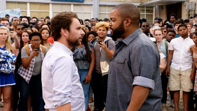 "Charlie Day as Andy Campbell and Ice Cube as Strickland in the comedy ""Fist Fight."""