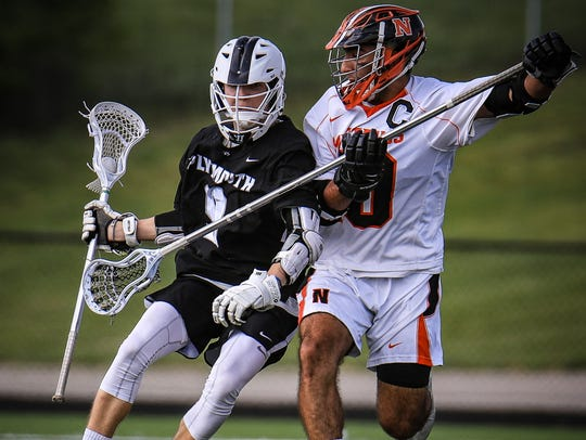 Action heats up between Plymouth's Gavin Roach (9) and Northville's Abe Khoury (10) during Wednesday's Division 1 boys lacrosse regional final at Tom Holzer Field.