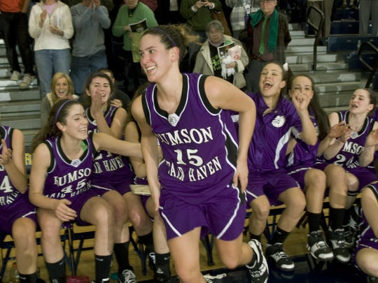 Rumson's Kate Miller jumps up from the bench as her