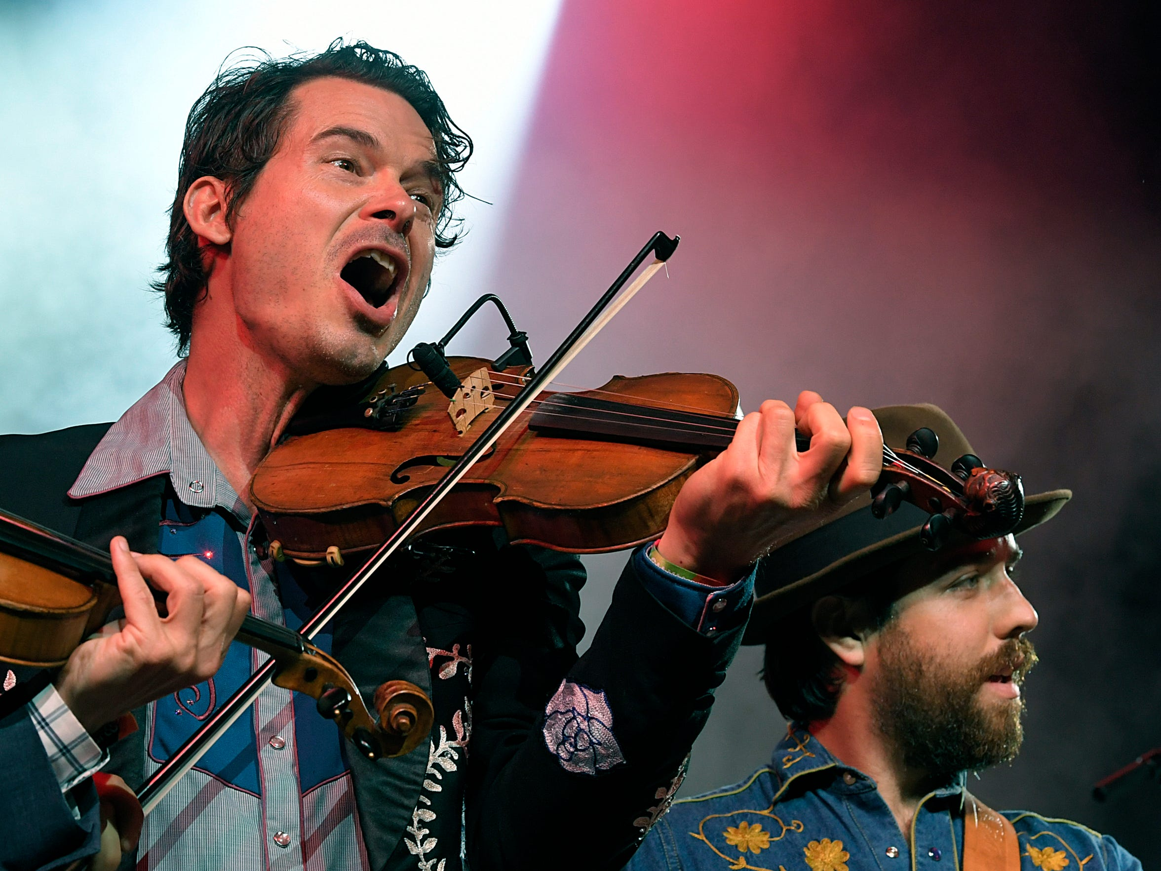 Old Crow Medicine Show's Ketch Secor sings during the Grand Ole Opry on the final night of the 17th annual Bonnaroo Music and Arts Festival in Manchester, Tenn., on June 10, 2018