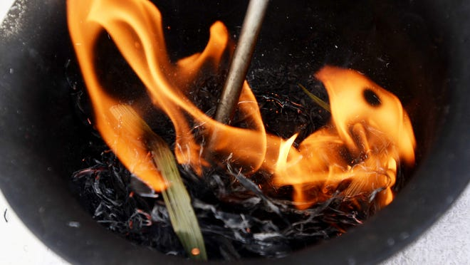 Palm fronds are burned at Christ United Methodist Church in preparation for Ash Wednesday.