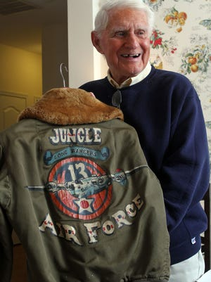 World War II veteran Arthur Weisleder holds his flight jacket during an interview in his Lakewood home Thursday, May 21, 2015. He served as a B-24 pilot in the Southwest Pacific region. ASB 0525 Carino's Corner LAKEWOOD, NJ WEISLEDER0521A STAFF PHOTO BY THOMAS P. COSTELLO