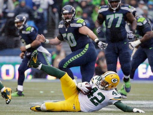 Green Bay Packers safety Morgan Burnett slides after