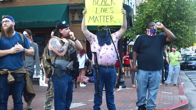 A group of armed men came to Sunday's demonstration in support of the protesters, according to one member of the group.