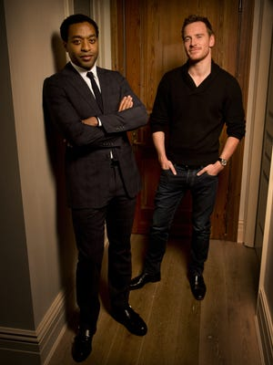 Chiwetel Ejiofor, left, and Michael Fassbender star in the drama '12 Years a Slave.'