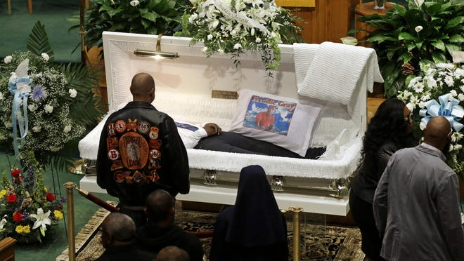 FILE -In this Monday, April 27, 2015 file photo, Mourners view the body of Freddie Gray before his funeral at New Shiloh Baptist Church, in Baltimore. Gray died from spinal injuries about a week after he was arrested and transported in a Baltimore Police Department van. With a city so deeply divided, the stakes for the police, the politicians and the public at the first officer's trial, Monday, Nov. 30, 2015, are high.