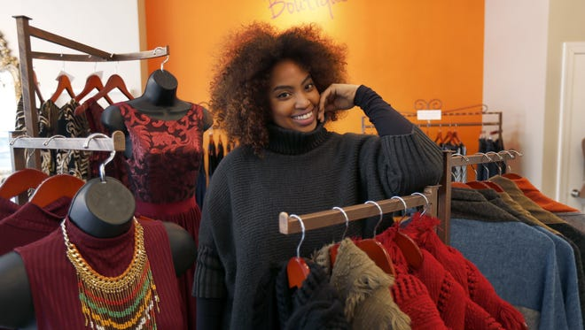 In this Wednesday, Jan. 20, 2016, photo, Tamika Maria Price poses for a portrait at her business, Standout Style Boutique, in Chicago's Lakeview neighborhood. A disappointing holiday shopping season has small and independent retailers thinking about how to get customers interested in shopping in 2016. After her holiday sales fell 25 percent compared with a year earlier at the boutique, Price is making plans for a brighter year by doubling her Facebook advertising to establish more of an emotional connection with shoppers. (AP Photo/Charles Rex Arbogast)