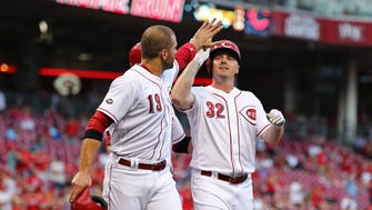 The Reds' Jay Bruce celebrates after hitting a three-run home run with Joey Votto, left, off the Diamondbacks' Robbie Ray in the third inning of a baseball game, Saturday, July 23, 2016, in Cincinnati.
