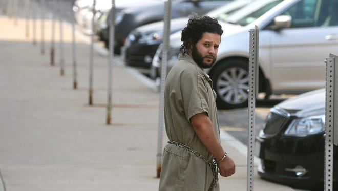 Mufid Elfgeeh is taken from his arraignment in federal court in Rochester on Monday.