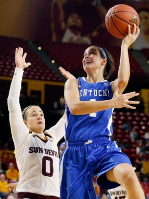 FILE - This Nov. 15, 2015 file photo shows Kentucky's Maci Morris, right, trying to get off a shot as Arizona State's Katie Hempen (0) defends during the first half of an NCAA college basketball game in Tempe, Ariz. Morris thought she would spend most of her freshman season at Kentucky settling in, getting used to big-time college basketball. Instead, she has become a significant contributor for the Wildcats. (AP Photo/Ross D. Franklin, file)