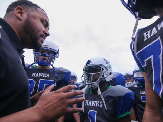 St. Georges football coach J.D. Maull and his Hawks