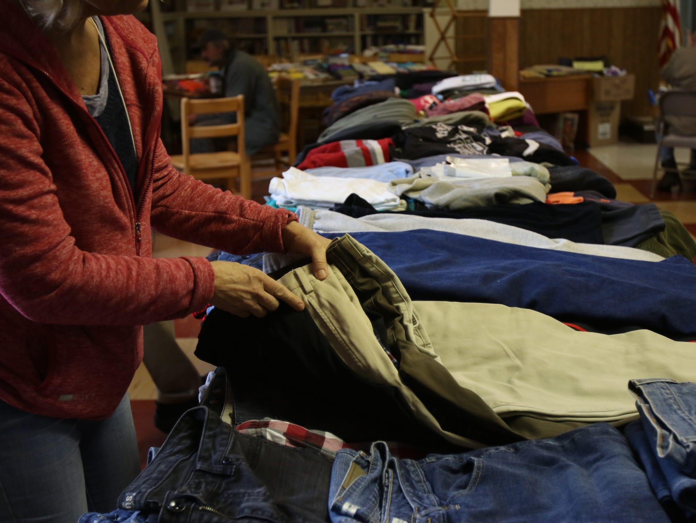 A volunteer sorts clothing at Trinity Lutheran Church