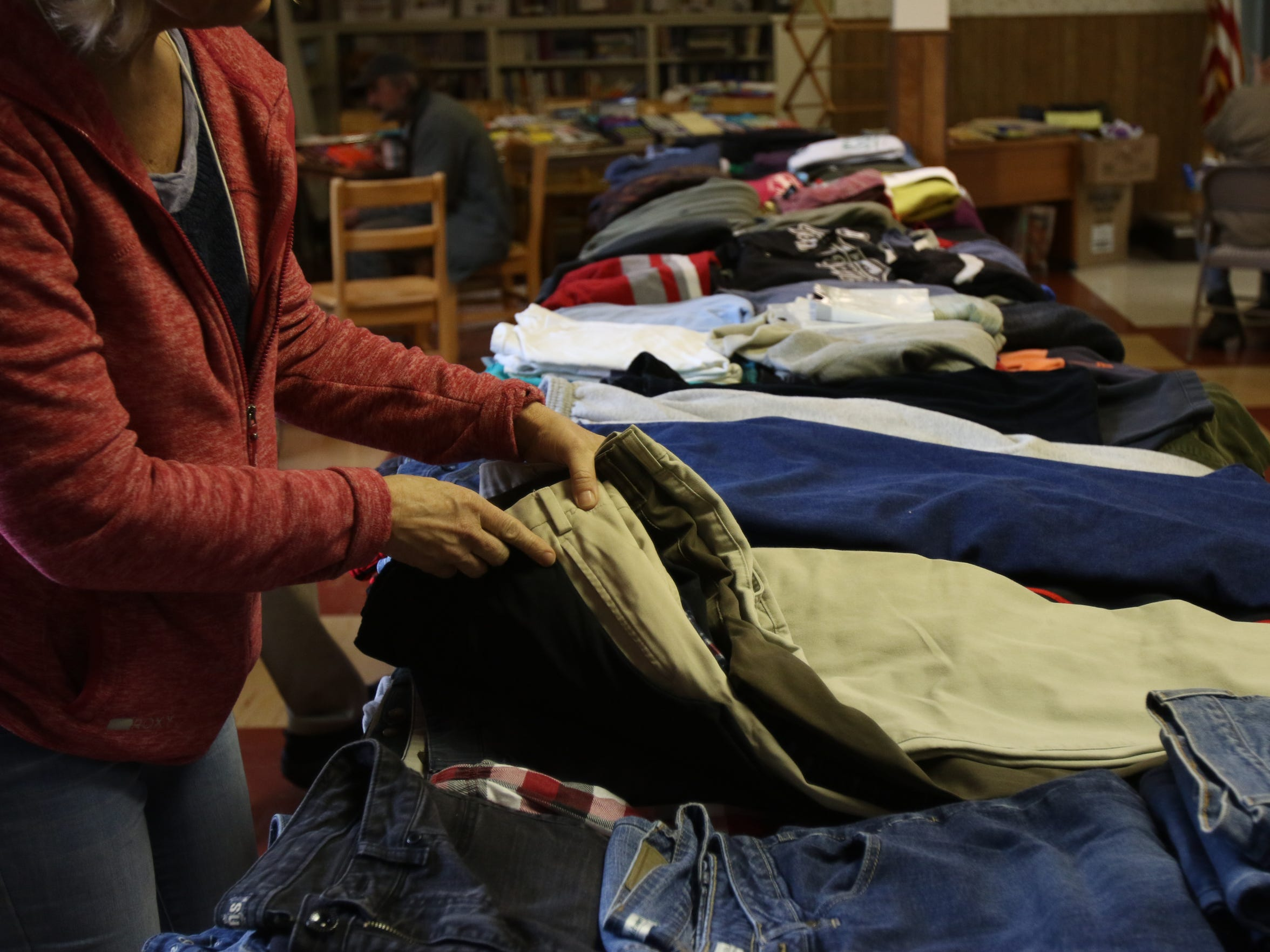 A volunteer sorts clothing at Trinity Lutheran Church