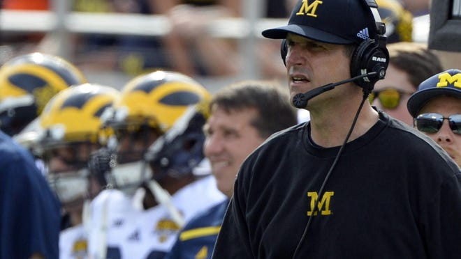 Michigan coach Jim Harbaugh has drawn criticism for pulling scholarship offers from recruits. Recruits often entertain multiple offers and rescind verbal commitments. At least part of the problem is the system itself, leading some to suggest an early signing period for college football.
