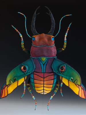 Stag beetle made of wood, paper, clay, fabric, wire and beads by Milwaukee artist Mary Hager